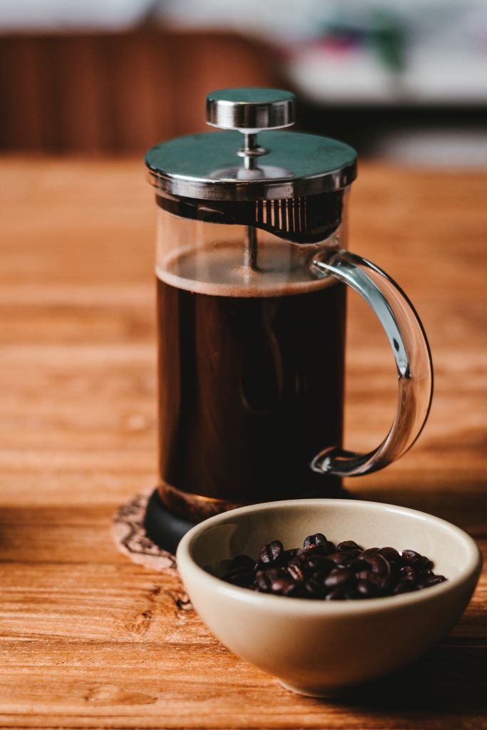 A French Press Device filled with Coffee