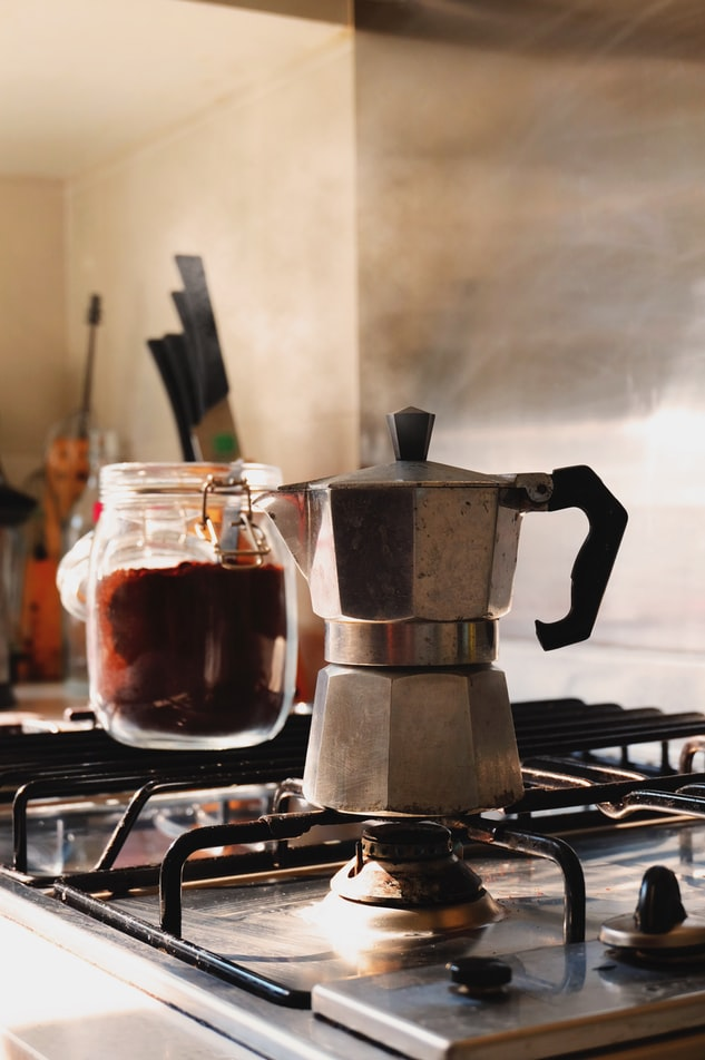 a moka pot on top of a stove