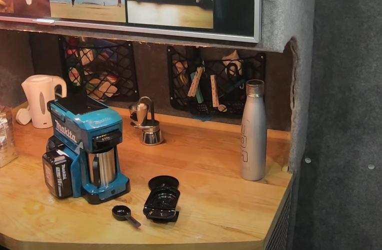 The Makita portable coffee maker set on a table